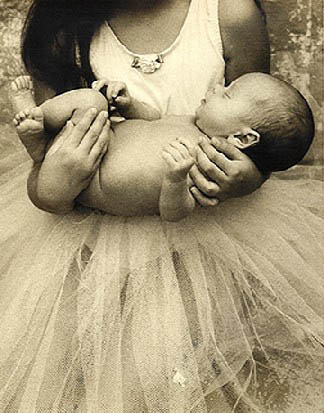 Sepia toned B/W photograph of baby in arm