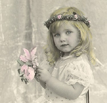 Hand colored photograph of little girl with flowers